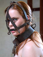 Mummificated submissive in latex