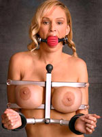 Blonde pornstar with shackled breast