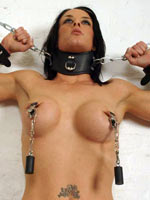 Brunette posing on BDSM session